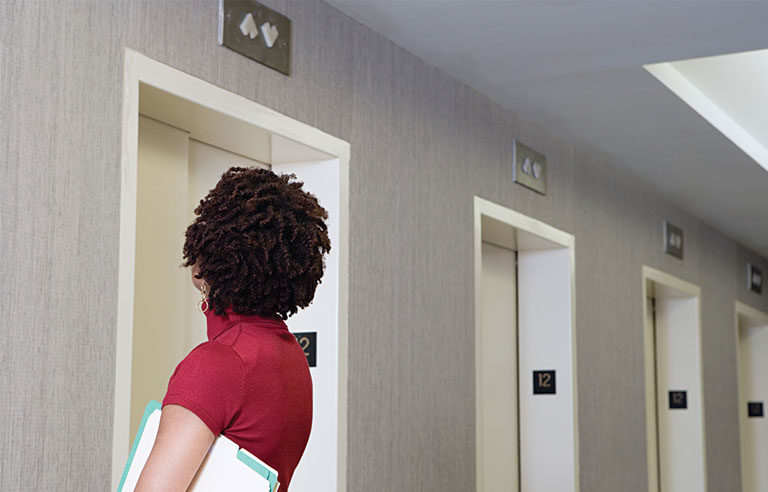 woman by elevator