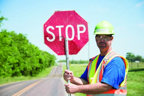 worker-holding-up-a-stop-sign.jpg