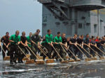 Sailors clean the deck
