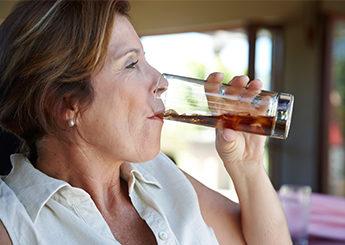 mature lady drinking soda
