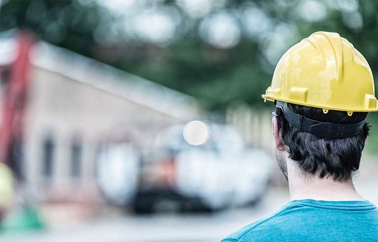 back-of-guy-with-yellow-hard-hat