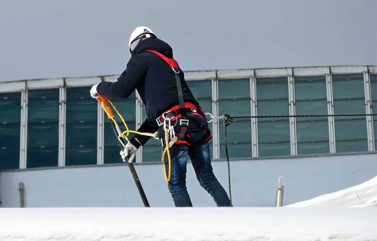 worker-roof-snow.jpg