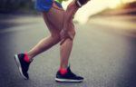 Woman holding leg