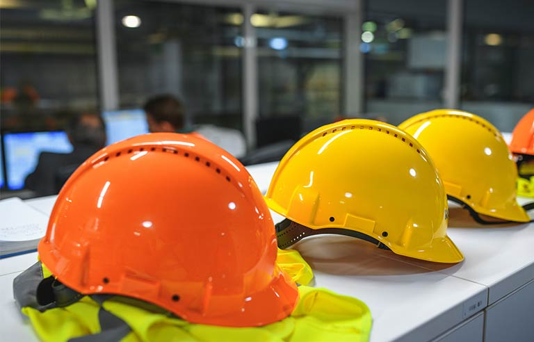 Orange yellow hard hats