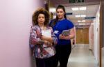 Nurses against pink walls