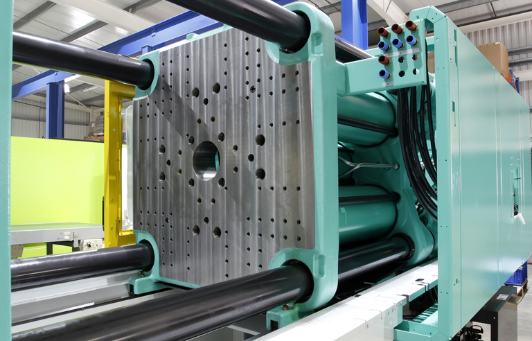 Plastics moulding machine