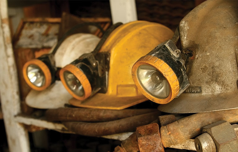 three mining helmets