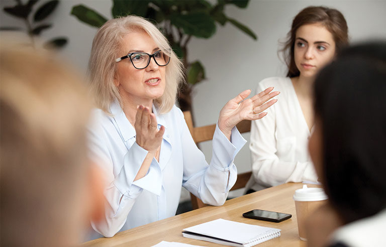 aged businesswoman in a meeting