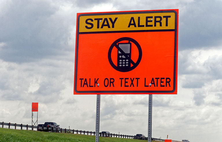 Don't drive distracted sign