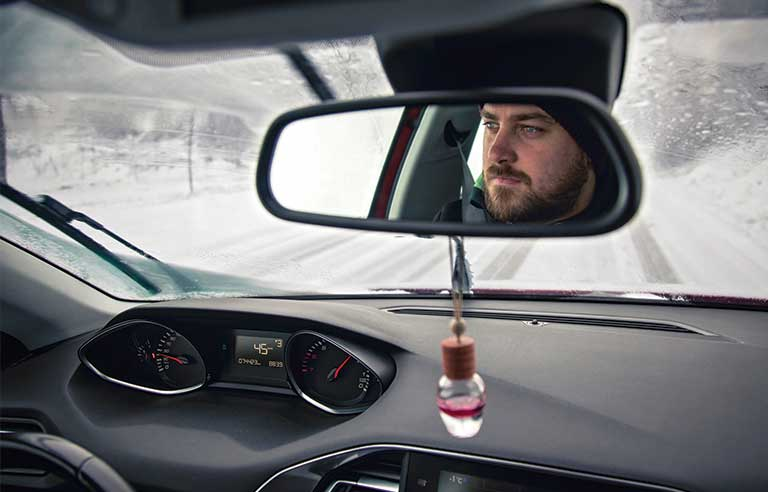 man-driving-snowy-condition.jpg