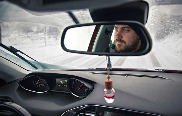 man driving snowy condition