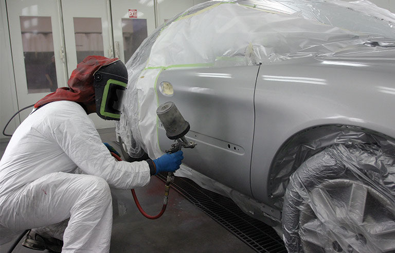 man painting car