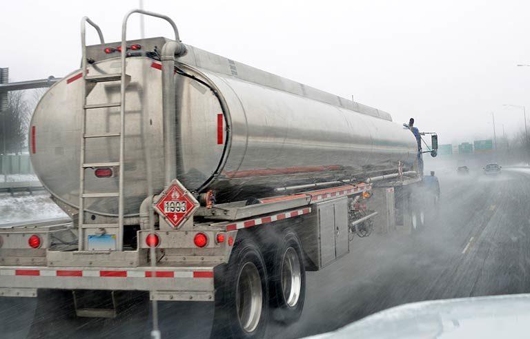 tanker truck-highway-wet-road