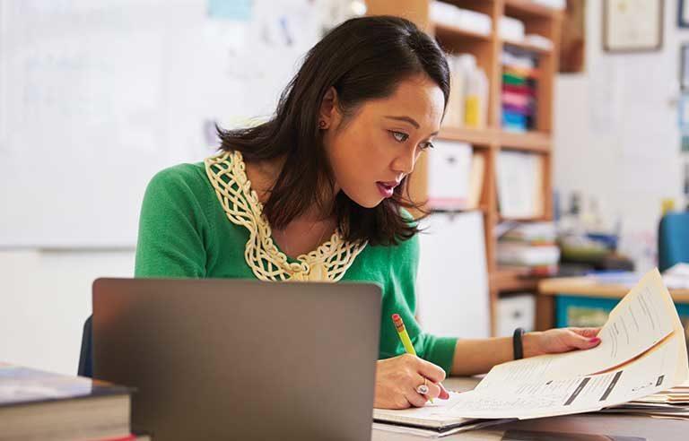 female-teacher-sitting