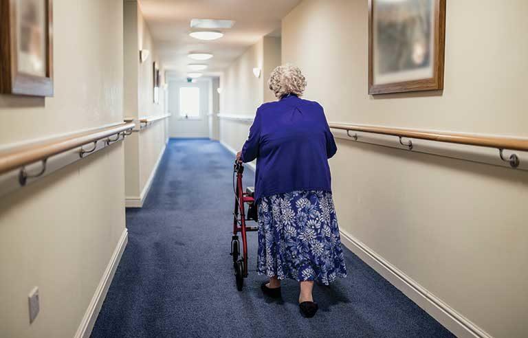 senior lady using walker